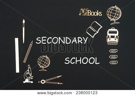 Concept Back To School, Text Secondary School With School Supplies Chipboard Miniatures Placed On Bl
