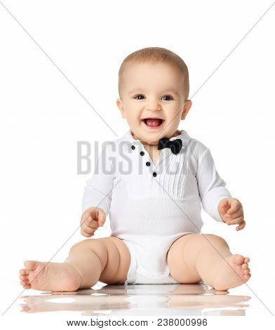 8 Month Infant Child Baby Boy Toddler Sitting In White Shirt And Black Tie Happy Smiling Isolated On