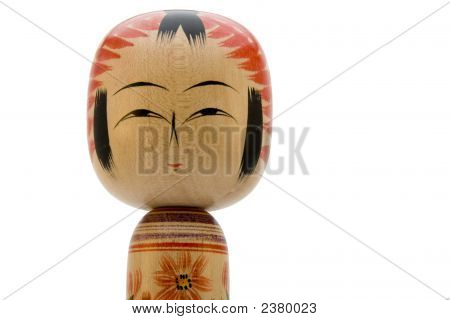 Japanese Kokeshi Doll On White Background