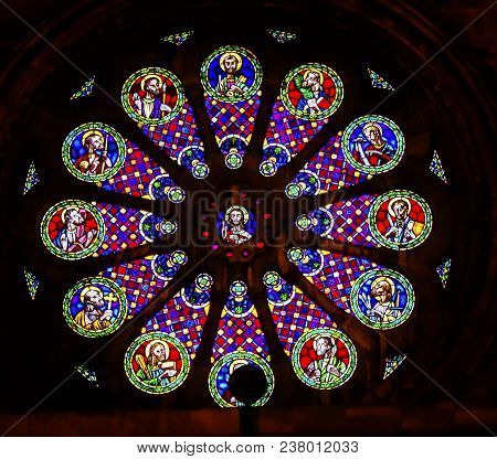 Lisbon, Portugal -  September 12, 2017 Rose Window Stained Glass Jesus Disciples Basilica The Se Sed