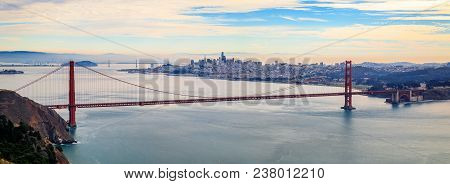 Panorama Of The Golden Gate Bridge On A Cloudy Day With The Marin Headlands In The Foreground And Sa