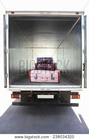 Open Metal Container Of  Truck With Suitcases Inside