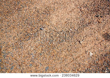 Brown Gravel Texture And Small Stone Background. Sand And Stones On The Floor. The Land Is Covered W