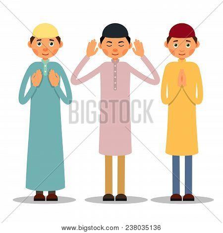 Muslim Praying. Three Muslim Men Stand And Pray. The Performance Of Muslim Prayer By Men With Raised