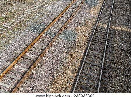Railroad tracks on railway embankment of rubble. Three railroad tracks. Railway background poster