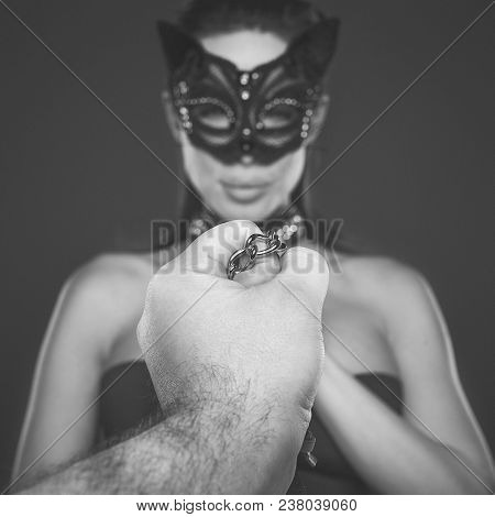 Strong Man Hand Holding Submissive Lover In Mask On Chain, Bdsm Concept, Black And White