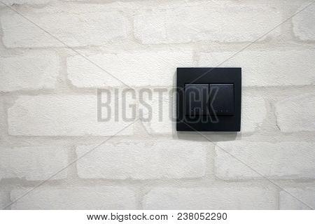 Black Switch On White Wallpaper. Black Switch Modern Style.
