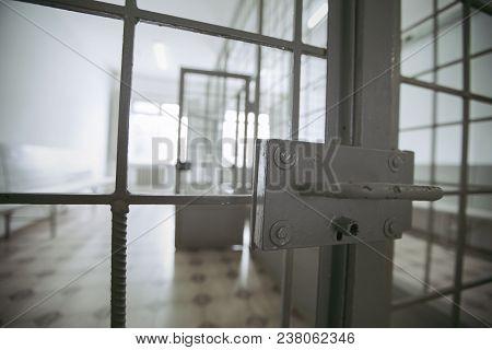 Metal Lock On The Prison Door. Metal Door Painted Green Paint. Blur Fone