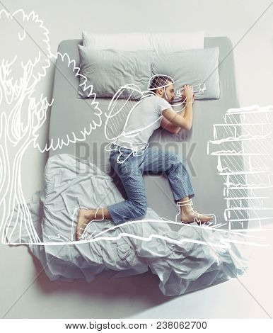 Top View Photo Of Young Man Sleeping In A Big White Bed. Dreams Concept. He Is Dreaming About Scout,