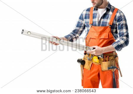 Close-up view of spirit level in hands of workman in orange overall isolated on white poster