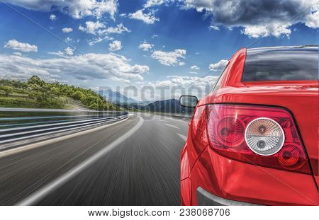 Red Car Rushing Along A High-speed Highway.