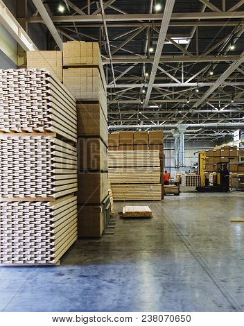 Modern Production And Storage Room With Lumber Produced And Ready For Shipment. Storage And Producti