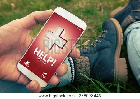 Injured man holding his smartphone calling rescue team with simple user-friendly smart phone application