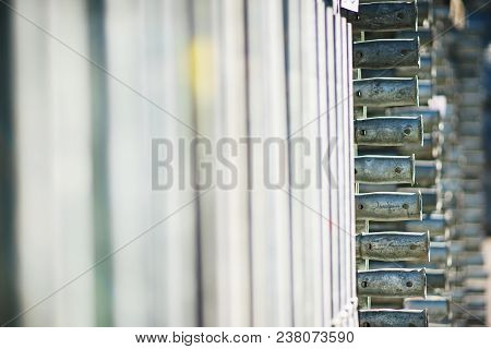 Metal Structures In A Warehouse In Stacks. Metal Supports For Scaffolding And Formwork. Soft Focus A