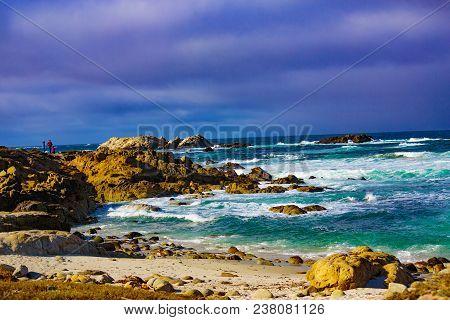 Pebble Beach, California, February 18, 2018:  Wave Action On The Rocks At Pebble Beach Highlighting