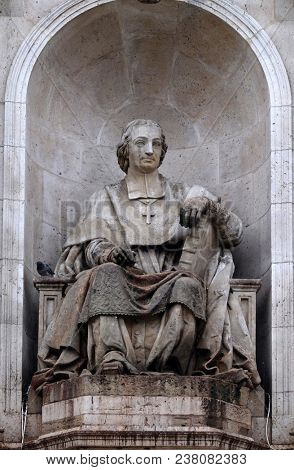 PARIS, FRANCE - JANUARY 04: The statue of Massillon by Jacques Fauginet, Fountain of the Sacred Orators, Place Saint Sulpice in Paris, France on January 04, 2018.