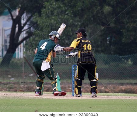 PUCHONG, MALAYSIA - SEPT 24: Malaysia's Mohd Safiq catches Guernsey's Ross Kneller's mishit at the Pepsi ICC World Cricket League Div 6 finals in Kinrara Oval on Sept 24, 2011 in Puchong, Malaysia.