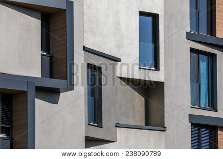 Contemporary design of multifamily living houses. Modern luxury apartments buildings
