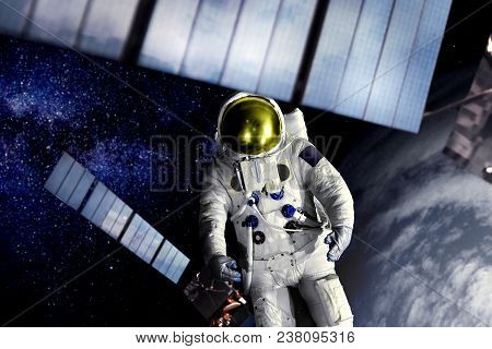 Astronaut Lost In The Space Near Satellite Watching Earth