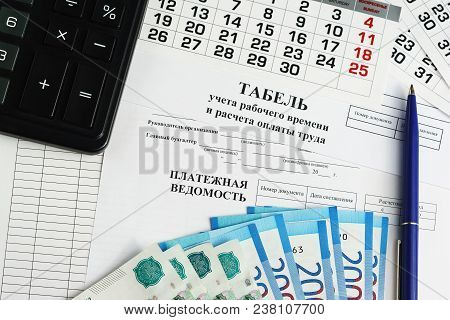 Documents For The Issuance Of Wages To Employees: Time Sheet And Payroll And Payroll. Money And A Bl