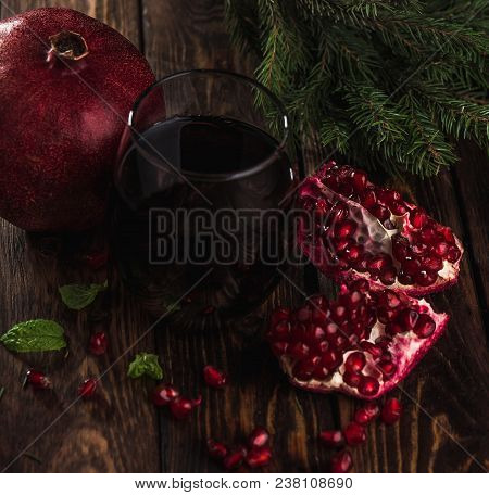 A Glass Of Pomegranate Juice With Fresh Pomegranate Fruits On Wooden Table. Vitamins And Minerals. H