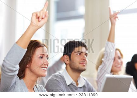 Women Raising Hands In Class