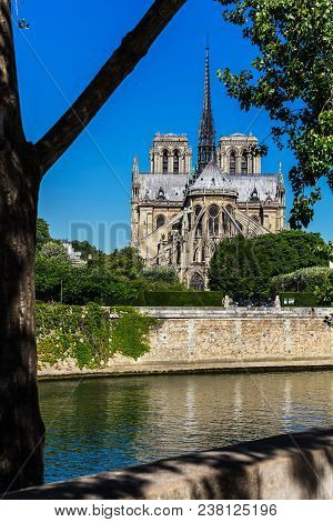 Notre Dame De Paris Cathedral On The Cite Island In The Summer Morning. Notre-dame Cathedral  Is A M