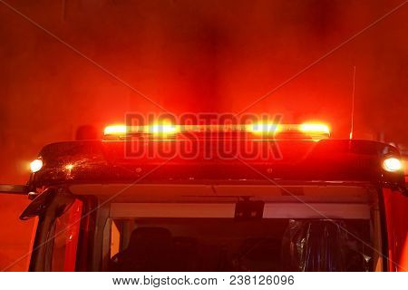 Red Lights Of A Fire Engine. Night Time. Fire Engine. Extinguishing The Fire. Close-up Of The Red Li