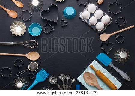 Baking Background With Eggs And Kitchen Tools: Rolling Pin, Wooden Spoons, Whisk, Sieve,  Bakeware A