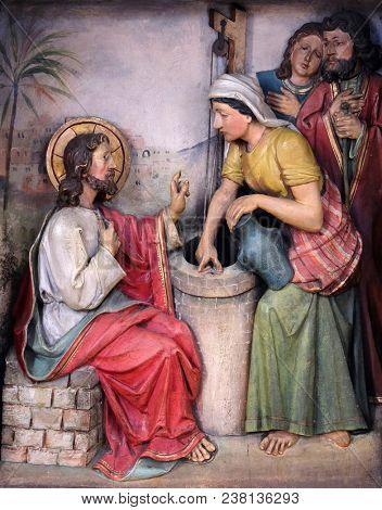 ZAGREB, CROATIA - OCTOBER 02: Jesus and the Samaritan Woman, relief in the church of Saint Martin in Zagreb, Croatia, on October 02, 2017.