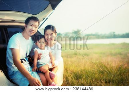 Drive In The Vacations Family; Asian Family Are Happy Sitting In The Open Trunk Of A Car; Travel Nat