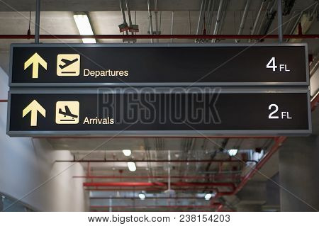 Departure And Arrivals Board Sign At International Airport