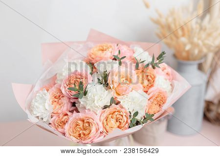 Bouquet Of Beautiful Flowers On Wooden Table. Floristry Concept. Spring Colors. The Work Of The Flor