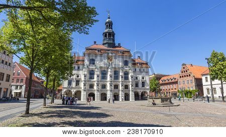 Lüneburg, Germany - 11. June 2015: Market Square And Town Hall In The Old Town Of Lüneburg. Locals A