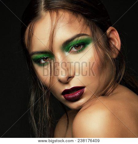 Dark Portrait Cute Brunette Girl With Green Makeup