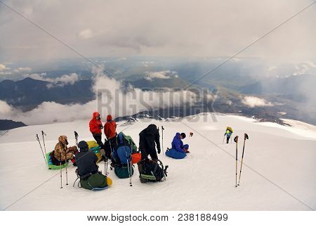 Group Of Climbers In The Mountain. Climb To The Top. Mountaineering And Climbing