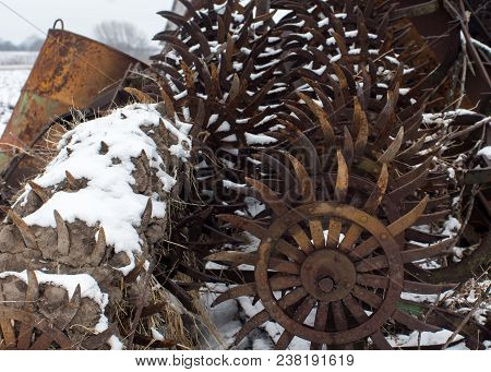 Rusty Antique Metal Farm Equipment An Implements With Snow