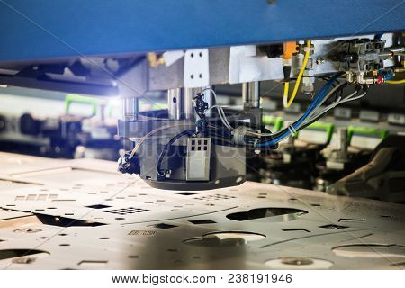 Robot For Stamping Metal Products During Work. Modern Automated Factory