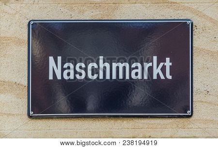 Street Sign Naschmarkt In Leipzig, Germany At A Wall