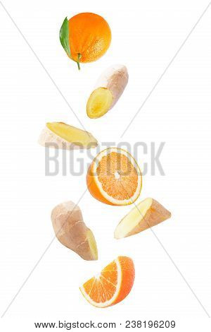 Isolated Falling Fruits. Flying Orange Fruit And Ginger Root Isolated On White Background With Clipp