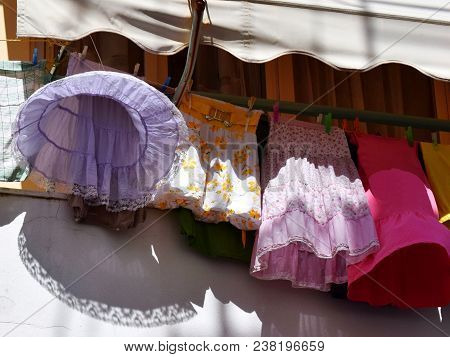 Skirts On String. Drying Clothes Ladies Skirts On The String On The Balcony