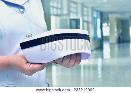 Nurses Are Holding A Nursing Cap. Nursing Uniform Concept