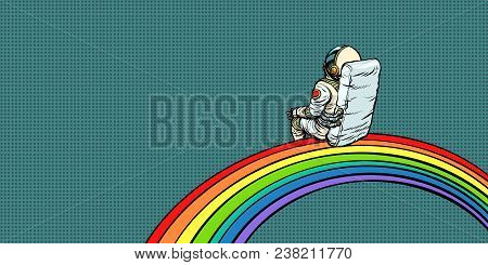 Astronaut Sits On A Rainbow. Pop Art Retro Vector Illustration Comic Cartoon Vintage Kitsch Drawing