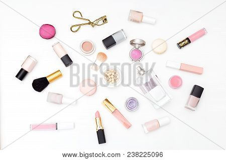 Set Of Cosmetics On A White Background And Macaroons. Flat Lay
