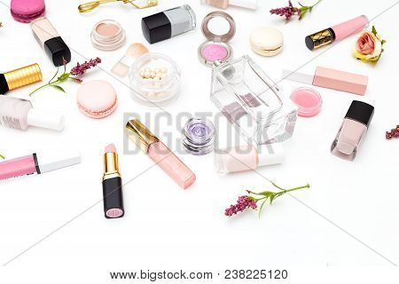 Make Up Products And Flowers On White Background. Beauty