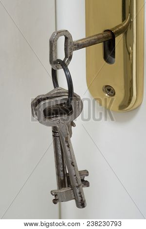 The Key Inserted In The Door Lock