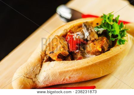 Goulash With Large Pieces Of Meat And Vegetables, All Served In Bread