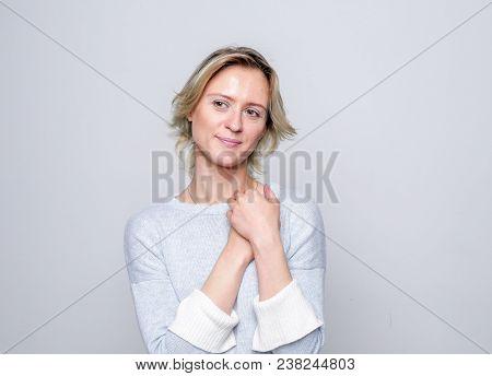 Adult Tenderness Woman Posing In Studio. Positive Emotions. Tenderness.