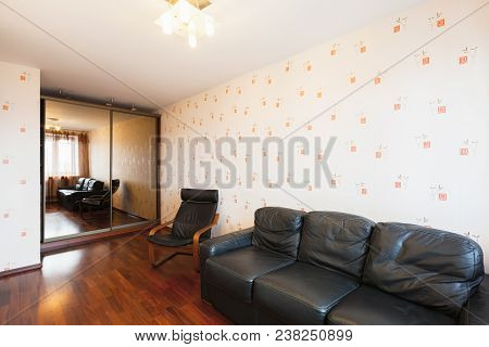 Contemporary Living Room Interior With Black Leather Chair And Sofa