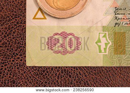 Kiev, Ukraine - December 19, 2014: Ukrainian Paper Money, Hryvnia, Lays Down On Brown Imitation Leat